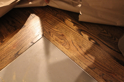 One home made the story of our little family 39 s journey for Wood floor up to fireplace