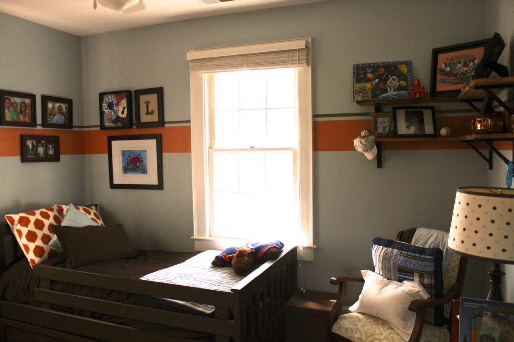 Landon's room with rustic wood and metal shelves.