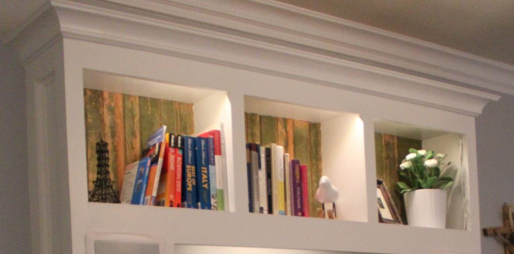 Close up of the shelves with bead boarding from a historic DC church and LED cabinet lighting.